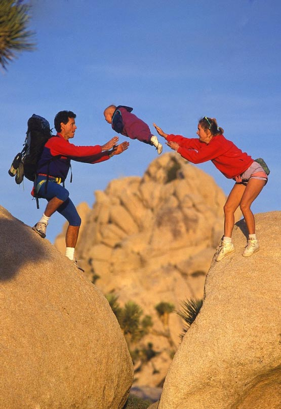 Photo of climbing couple tossing baby: Real or fake?